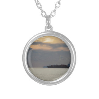 Warm sea sunset with cargo ship at the horizon silver plated necklace