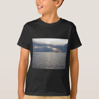 Warm sea sunset with cargo ship at the horizon T-Shirt