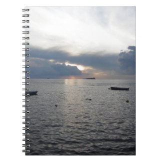 Warm sea sunset with cargo ships notebook
