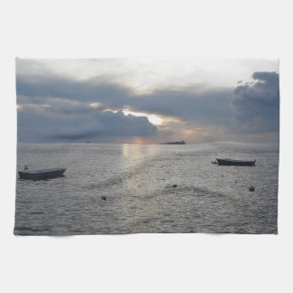 Warm sea sunset with cargo ships towels