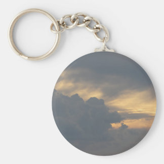 Warm sky with giants cumulonimbus clouds at sunset basic round button keychain