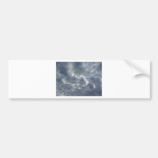 Warm sky with giants cumulonimbus clouds at sunset bumper sticker