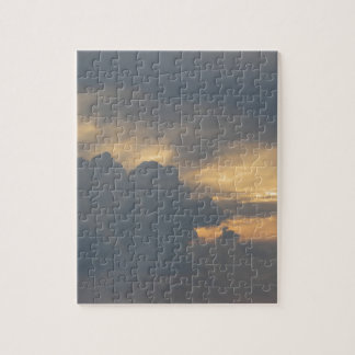 Warm sky with giants cumulonimbus clouds at sunset jigsaw puzzle