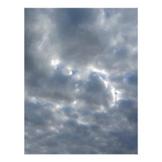 Warm sky with giants cumulonimbus clouds at sunset letterhead