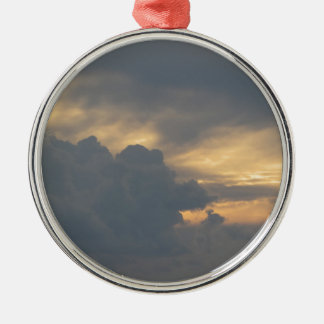 Warm sky with giants cumulonimbus clouds at sunset metal ornament