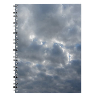 Warm sky with giants cumulonimbus clouds at sunset notebooks