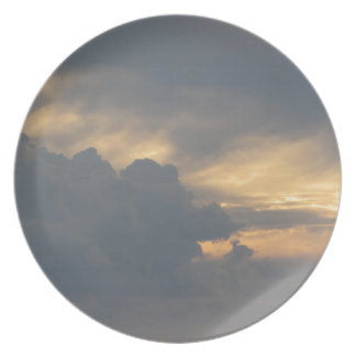 Warm sky with giants cumulonimbus clouds at sunset plate