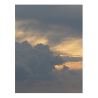 Warm sky with giants cumulonimbus clouds at sunset postcard