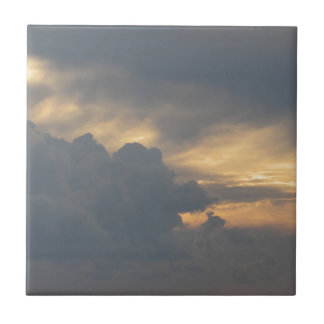 Warm sky with giants cumulonimbus clouds at sunset tile