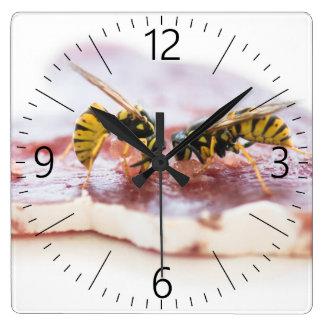 Wasps eating a sausage square wall clock