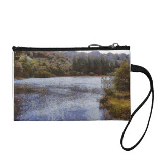 Water body surrounded by greenery coin purse
