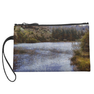 Water body surrounded by greenery wristlet