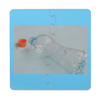 water bottle emptied on coaster puzzle drink coaster puzzle