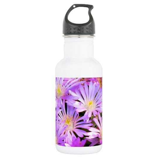 Water bottle with purple flowers close up