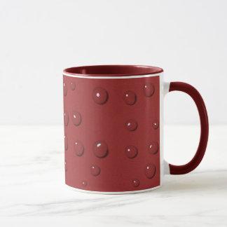 Water drops on amaranth red sand mug
