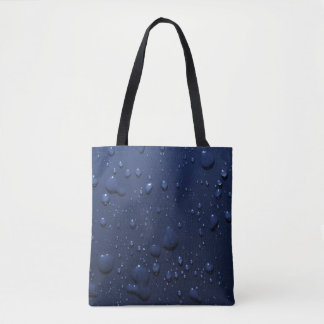Water drops on dark blue background tote bag