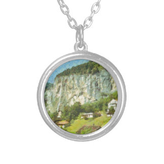Water falling off a cliff silver plated necklace