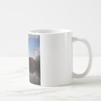 Water Haze Clouds Mountains Mug