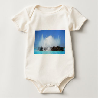 Water hitting rocks on canary islands baby bodysuit