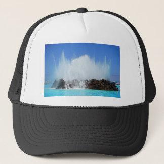 Water hitting rocks on canary islands trucker hat