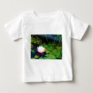 Water lily floating in a pond baby T-Shirt