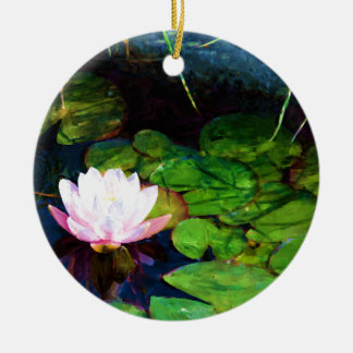 Water lily floating in a pond round ceramic ornament