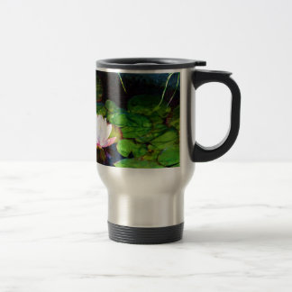 Water lily floating in a pond travel mug