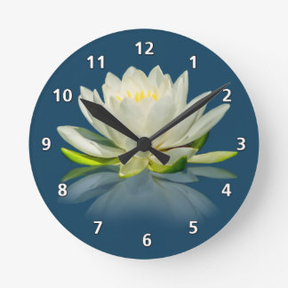 Water Lily Reflected on Blue Water Round Clocks