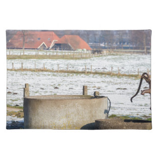 Water pump and well in winter snow landscape placemat
