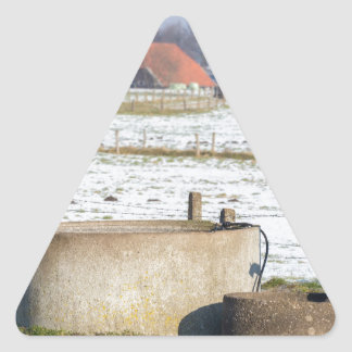 Water pump and well in winter snow landscape triangle sticker