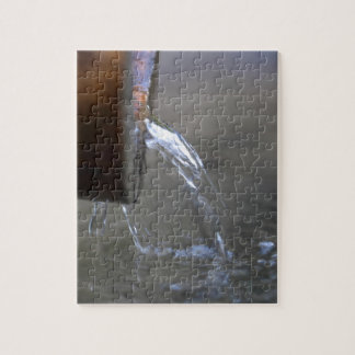 Water stream on  a well jigsaw puzzle