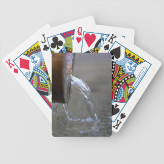 Water stream on  a well poker deck