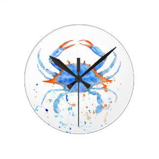 Watercolor blue crab paint splatter round clock