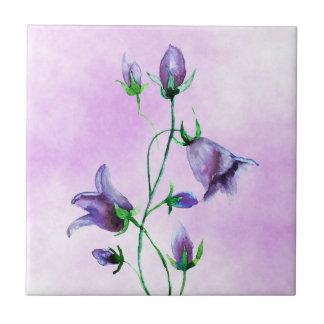 Watercolored violet bluebells on violet tile