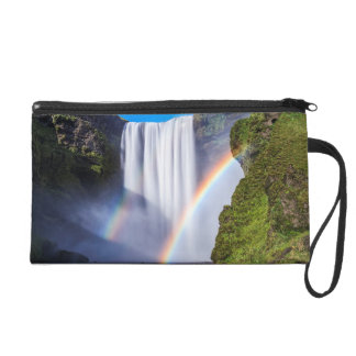 Waterfall and rainbow wristlet clutches