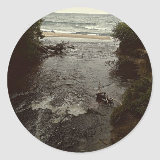 Waterfall in the beach classic round sticker