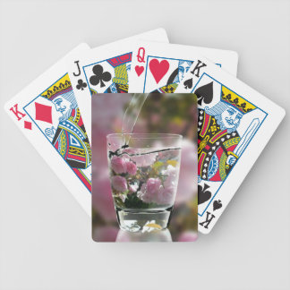 Watering Pink Flowers In A Glass Poker Deck