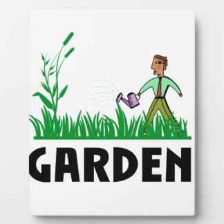 watering the garden plaque