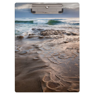 Wave breaking on beach, California Clipboards