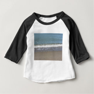 Wave of the sea on the sand beach baby T-Shirt