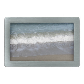 Wave of the sea on the sand beach belt buckle