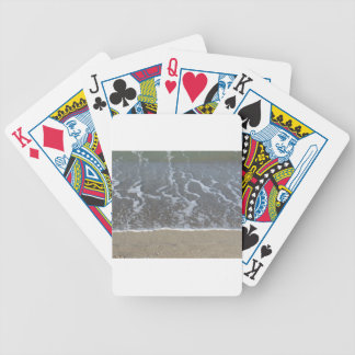 Wave of the sea on the sand beach bicycle playing cards