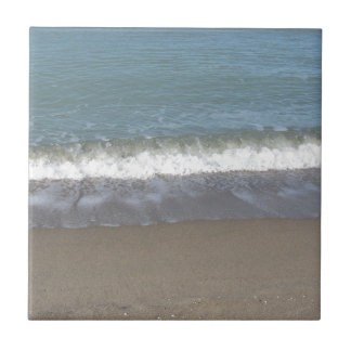 Wave of the sea on the sand beach ceramic tiles