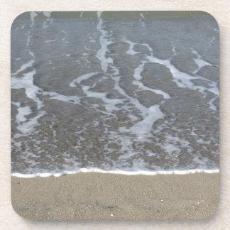 Wave of the sea on the sand beach coaster