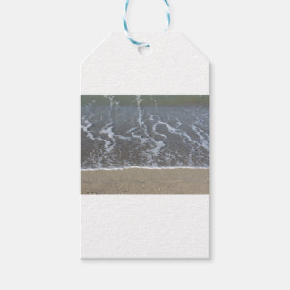 Wave of the sea on the sand beach gift tags
