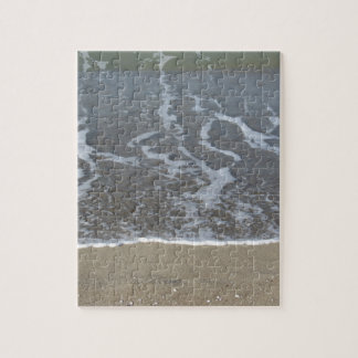 Wave of the sea on the sand beach jigsaw puzzle