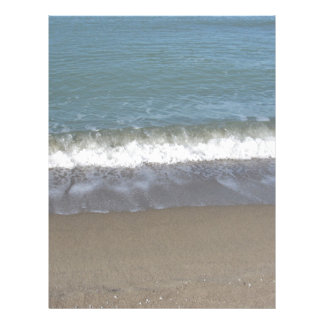Wave of the sea on the sand beach letterhead