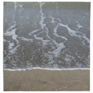 Wave of the sea on the sand beach napkin