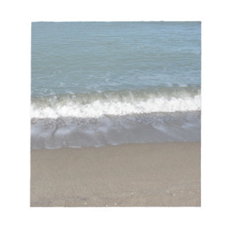 Wave of the sea on the sand beach notepads