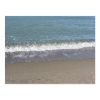 Wave of the sea on the sand beach postcard